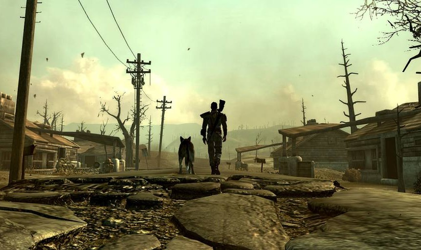 Gender ambiguous person and dog walking through a destroyed town, with buildings and telephone wires above them