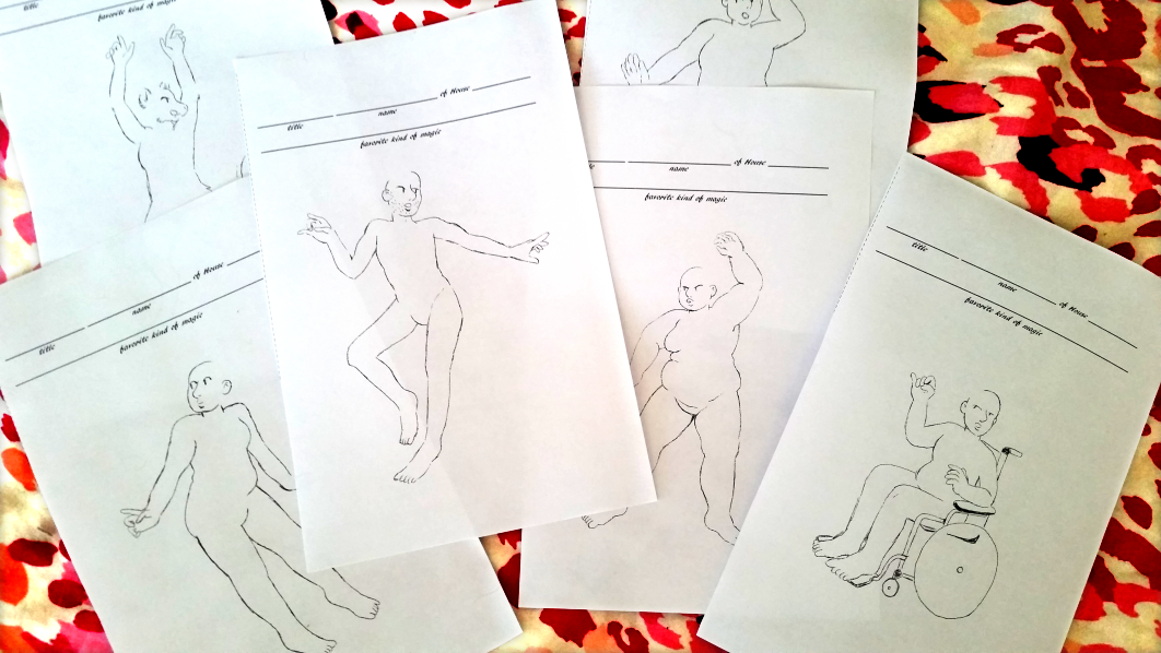 Six pages are on a table. Each page has a figure drawn on it in a different pose and with a different body shape. One is sitting in a wheelchair.