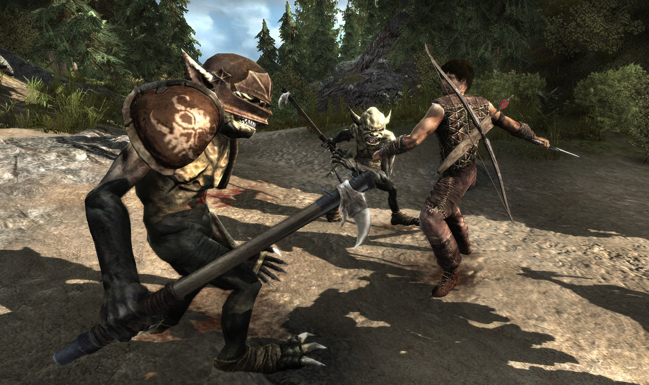 A masculine figure fights two goblin-like creatures outside in a forest clearing.
